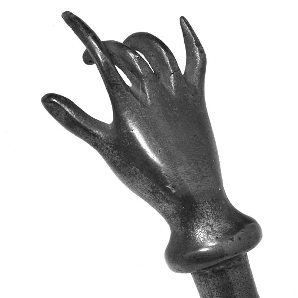 1923.47.27_Brass amulet against evil eye